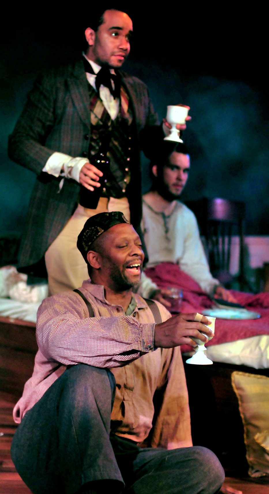 Michael J. Asberry (foreground), Anthony Simone (left), and Sean Patrick Nill (left) in STC's production of The Whipping Man.